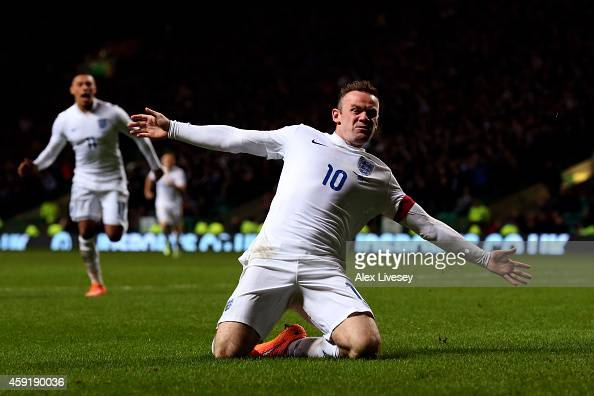 Wayne Rooney of England celebrates after scoring his team's second goal during the International Friendly match between Scotland and England at...