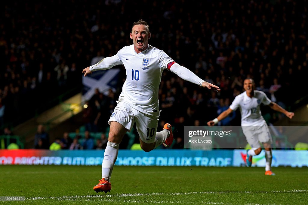 Wayne Rooney of England celebrates after scoring his team's third goal during the International Friendly match between Scotland and England at Celtic...