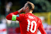 Wayne Rooney of England celebrates after scoring the opening goal equalling the record of 49 goals set by Sir Bobby Charlton during the UEFA EURO...