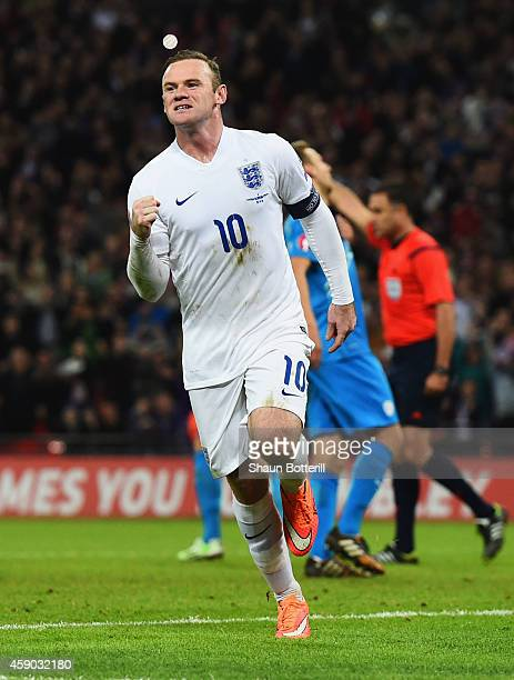Wayne Rooney of England celebrates as he scores their first and equalising goal from a penalty during the EURO 2016 Qualifier Group E match between...