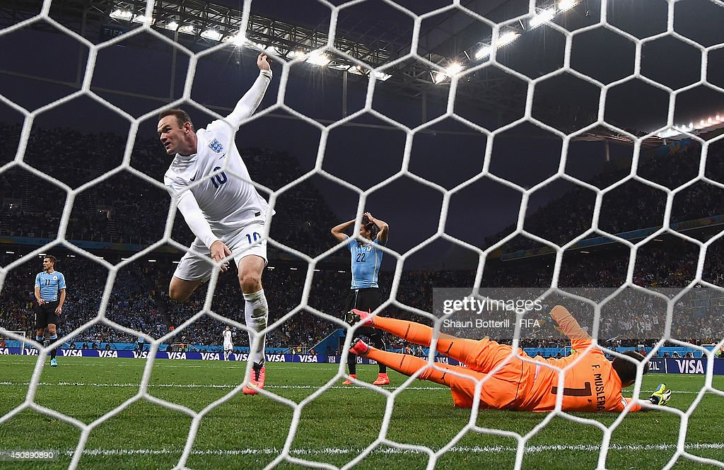 <a gi-track='captionPersonalityLinkClicked' href=/galleries/search?phrase=Wayne+Rooney&family=editorial&specificpeople=157598 ng-click='$event.stopPropagation()'>Wayne Rooney</a> of England celebrates scoring his team's first goal during the 2014 FIFA World Cup Brazil Group D match between Uruguay and England at Arena de Sao Paulo on June 19, 2014 in Sao Paulo, Brazil.