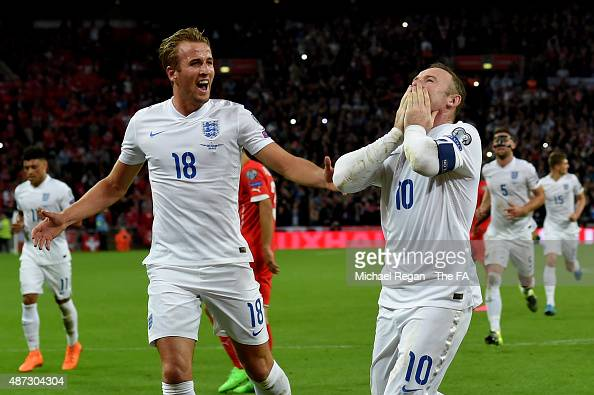 Wayne Rooney of England celebrates scoring his team's second goal breaking the record of 49 goals set by Sir Bobby Charlton with Harry Kane during...