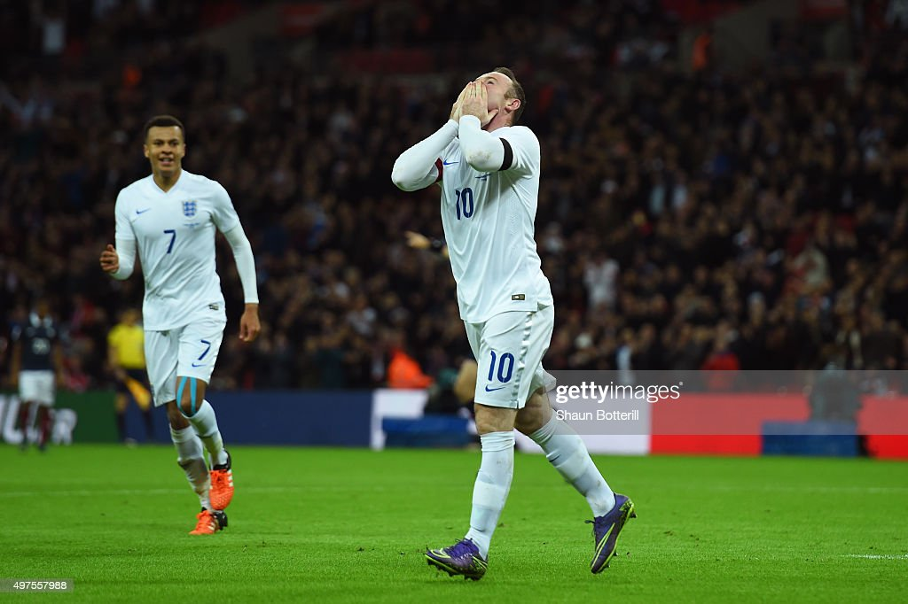 Wayne Rooney (L) of England celebrates scoring his team's second goal during the International Friendly match between England and France at Wembley Stadium on November 17, 2015 in London, England.