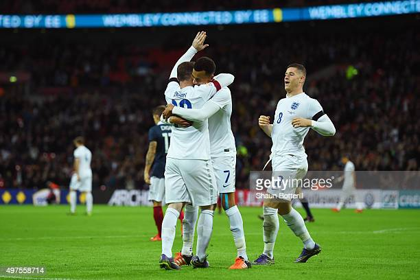 Wayne Rooney of England celebrates scoring his team's second goal with his team mate Dele Alli and Ross Barkley during the International Friendly...