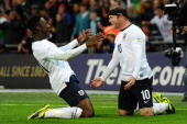 Wayne Rooney of England celebrates scoring the first goal with Danny Welbeck of England during the FIFA 2014 World Cup Qualifying Group H match...