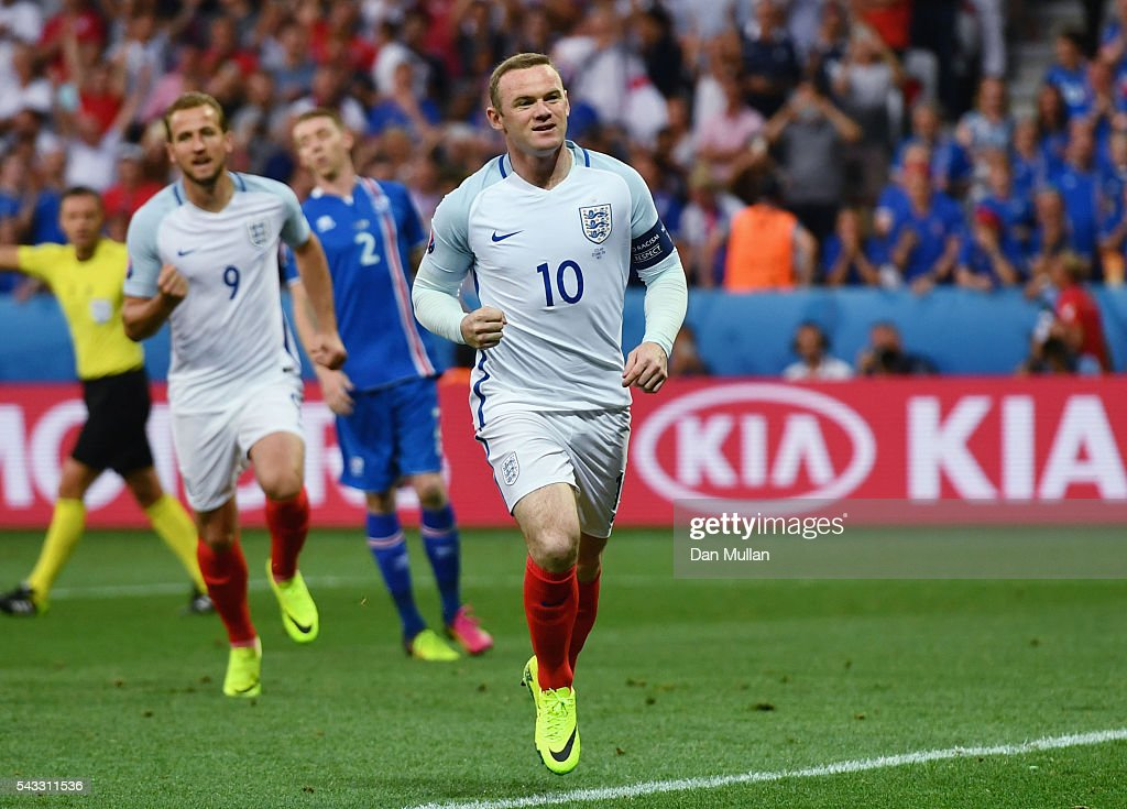 Wayne Rooney of England celebrates scoring the opening goal during the UEFA EURO 2016 round of 16 match between England and Iceland at Allianz...