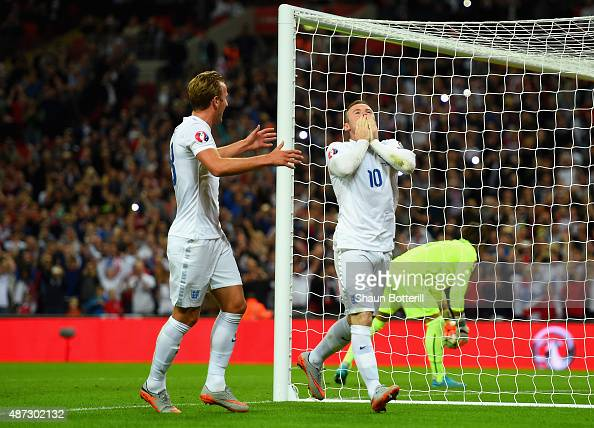 Wayne Rooney of England celebrates scoring their second goal from the penalty spot with Harry Kane of England during the UEFA EURO 2016 Group E...