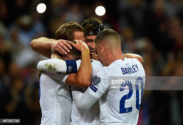 Wayne Rooney of England celebrates scoring their second goal from the penalty spot with Harry Kane Gary Cahill and Ross Barkley of England during the...