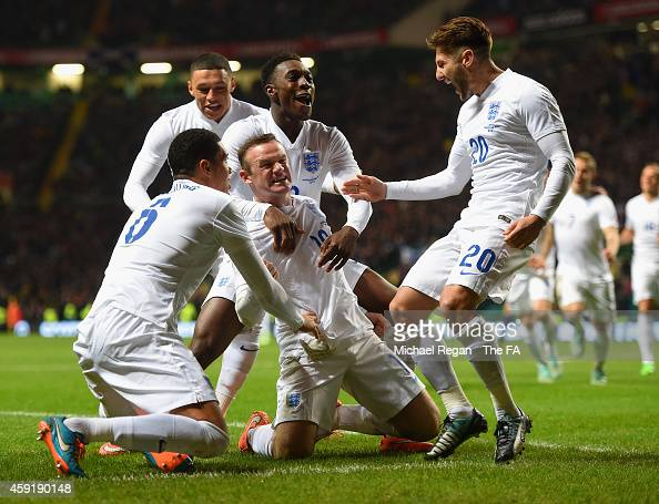 Wayne Rooney of England celebrates scoring their second goal with team mates during the International Friendly between Scotland and England at Celtic...