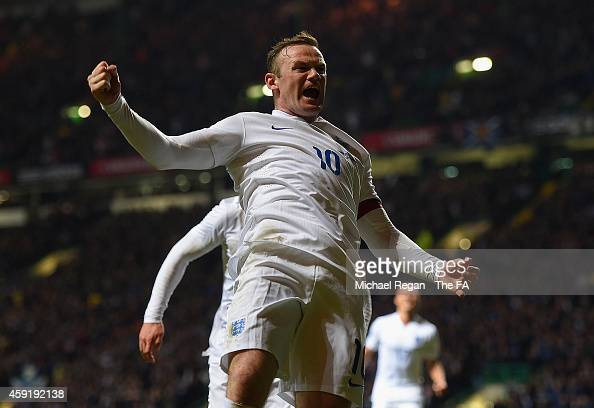 Wayne Rooney of England celebrates scoring their third goal during the International Friendly between Scotland and England at Celtic Park Stadium on...