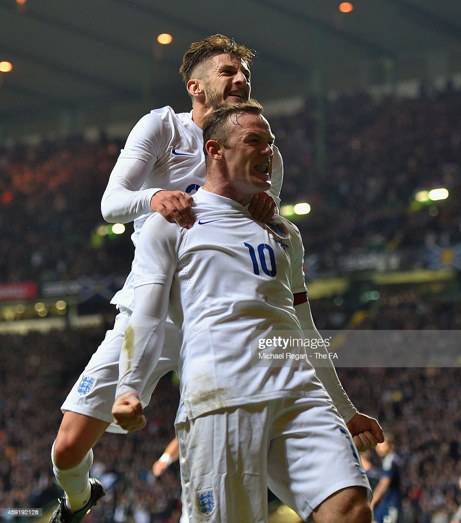 <a gi-track='captionPersonalityLinkClicked' href=/galleries/search?phrase=Wayne+Rooney&family=editorial&specificpeople=157598 ng-click='$event.stopPropagation()'>Wayne Rooney</a> of England celebrates scoring their third goal with <a gi-track='captionPersonalityLinkClicked' href=/galleries/search?phrase=Adam+Lallana&family=editorial&specificpeople=5475862 ng-click='$event.stopPropagation()'>Adam Lallana</a> of England during the International Friendly between Scotland and England at Celtic Park Stadium on November 18, 2014 in Glasgow, Scotland.