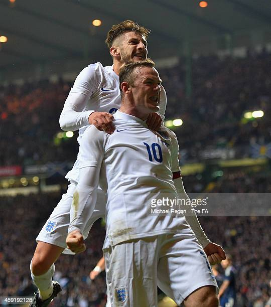 Wayne Rooney of England celebrates scoring their third goal with Adam Lallana of England during the International Friendly between Scotland and...