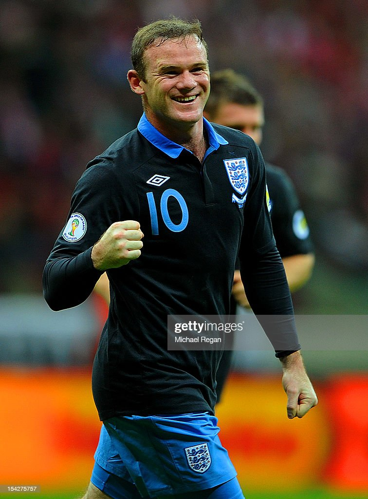 <a gi-track='captionPersonalityLinkClicked' href=/galleries/search?phrase=Wayne+Rooney&family=editorial&specificpeople=157598 ng-click='$event.stopPropagation()'>Wayne Rooney</a> of England celebrates scoring to make it 1-0 during the FIFA 2014 World Cup Qualifier between Poland and England at the National Stadium on October 17, 2012 in Warsaw, Poland.