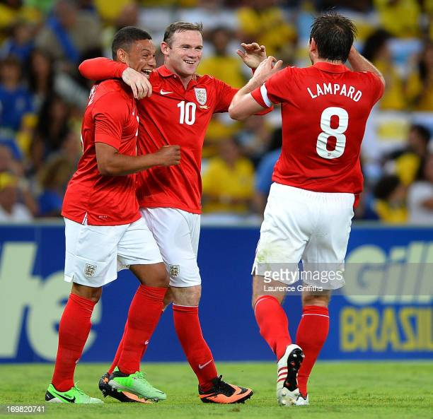 Wayne Rooney of England celebrates scorong the second goal with Alex Oxlade Chamberlain and Frank Lampard during the International Friendly match...