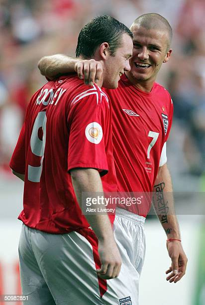 Wayne Rooney of England celebrates with David Beckham after scoring their second goal during the UEFA Euro 2004 Group B match between Croatia and...