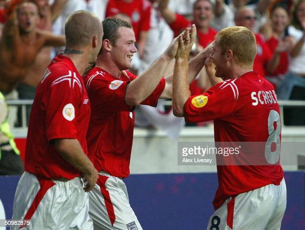 Wayne Rooney of England celebrates with David Beckham and Paul Scholes after scoring the second goal during the UEFA Euro 2004 Group B match between...