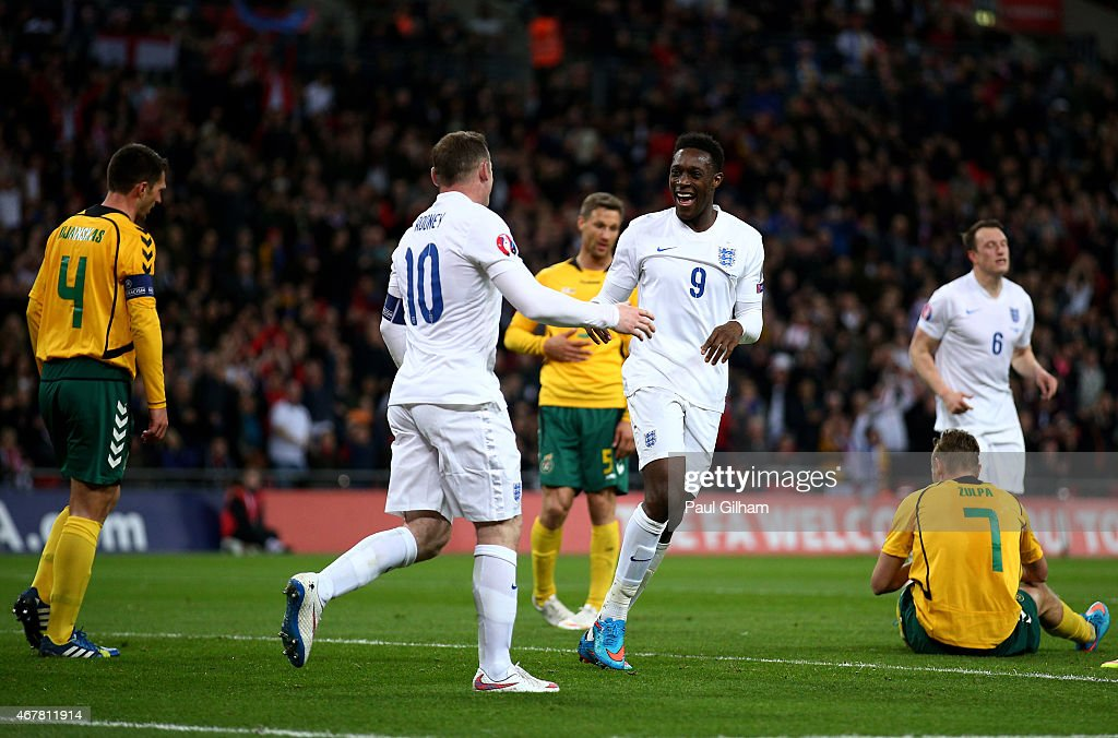 Wayne Rooney of England celebrates with goal scorer Danny Welbeck of England during the EURO 2016 Qualifier match between England and Lithuania at...