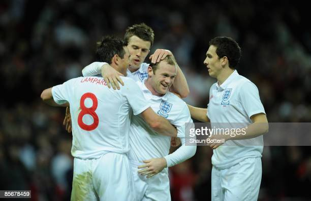 Wayne Rooney of England celebrates with his team mates after he scored during the International Friendly match between England and Slovakia at...