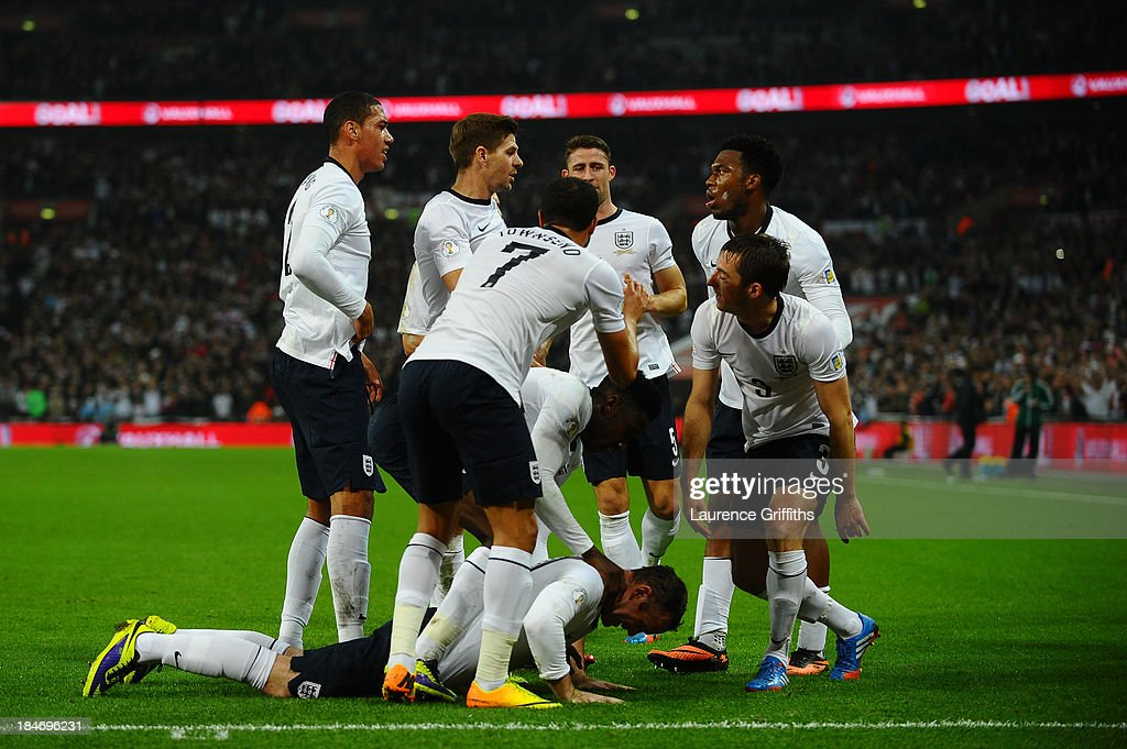 Wayne Rooney of England celebrates with team mates after scoring his team's opening goal during the FIFA 2014 World Cup Qualifying Group H match between England and Poland at Wembley Stadium on October 15, 2013 in London, England.