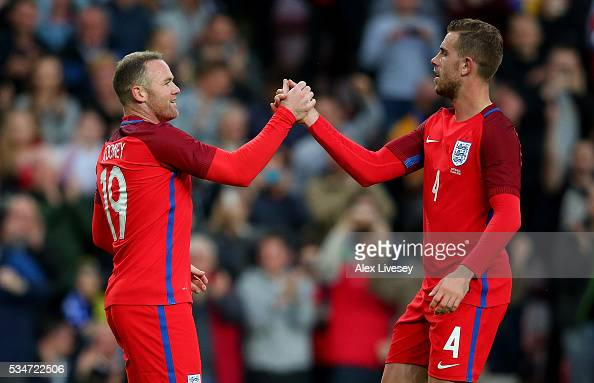 Wayne Rooney of England celebrates with team mates after scoring his team's second goal of the game during the International Friendly match between...