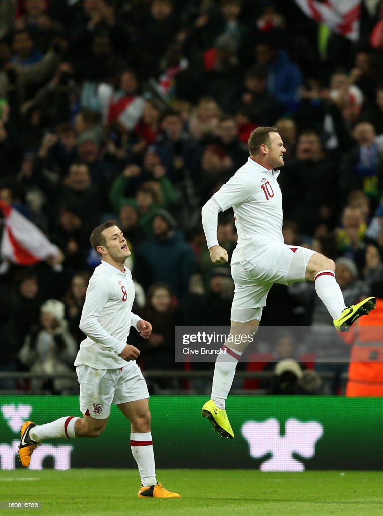 <a gi-track='captionPersonalityLinkClicked' href=/galleries/search?phrase=Wayne+Rooney&family=editorial&specificpeople=157598 ng-click='$event.stopPropagation()'>Wayne Rooney</a> of England (R) celebrates with team-mate <a gi-track='captionPersonalityLinkClicked' href=/galleries/search?phrase=Jack+Wilshere&family=editorial&specificpeople=5446655 ng-click='$event.stopPropagation()'>Jack Wilshere</a> of England after he scores the opening goal during the International friendly between England and Brazil at Wembley Stadium on February 6, 2013 in London, England.
