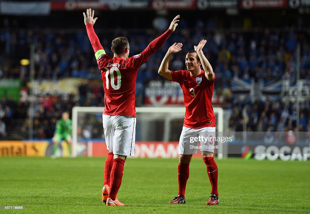 Wayne Rooney (L) of England celebrates with teammate Leighton Baines (R) after scoring the opening goal from a free kick during the EURO 2016 Qualifier match between Estonia and England at A. Le Coq Arena on October 12, 2014 in Tallinn, Estonia.