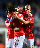Wayne Rooney of England celebrates with teammates Leighton Baines and Jack Wilshere after scoring the opening goal from a free kick during the EURO...