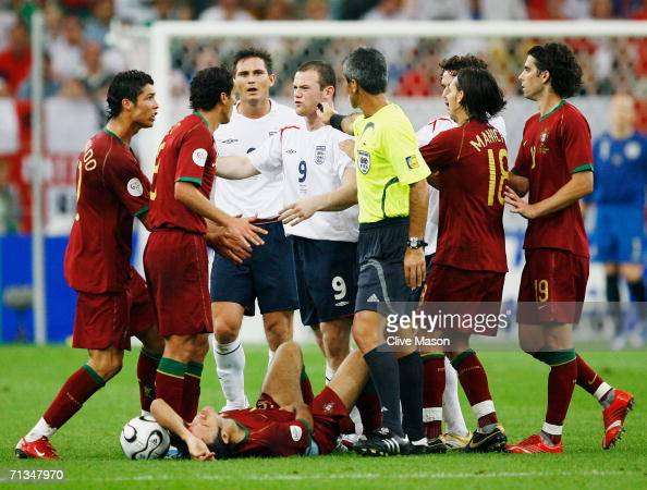 Wayne Rooney of England clashes with the Portuguese players before being sent off by Referee Horacio Elizondo of Argentina during the FIFA World Cup...