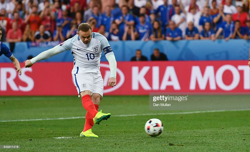 Wayne Rooney of England converts the penalty to score the opening goal during the UEFA EURO 2016 round of 16 match between England and Iceland at Allianz Riviera Stadium on June 27, 2016 in Nice, France.