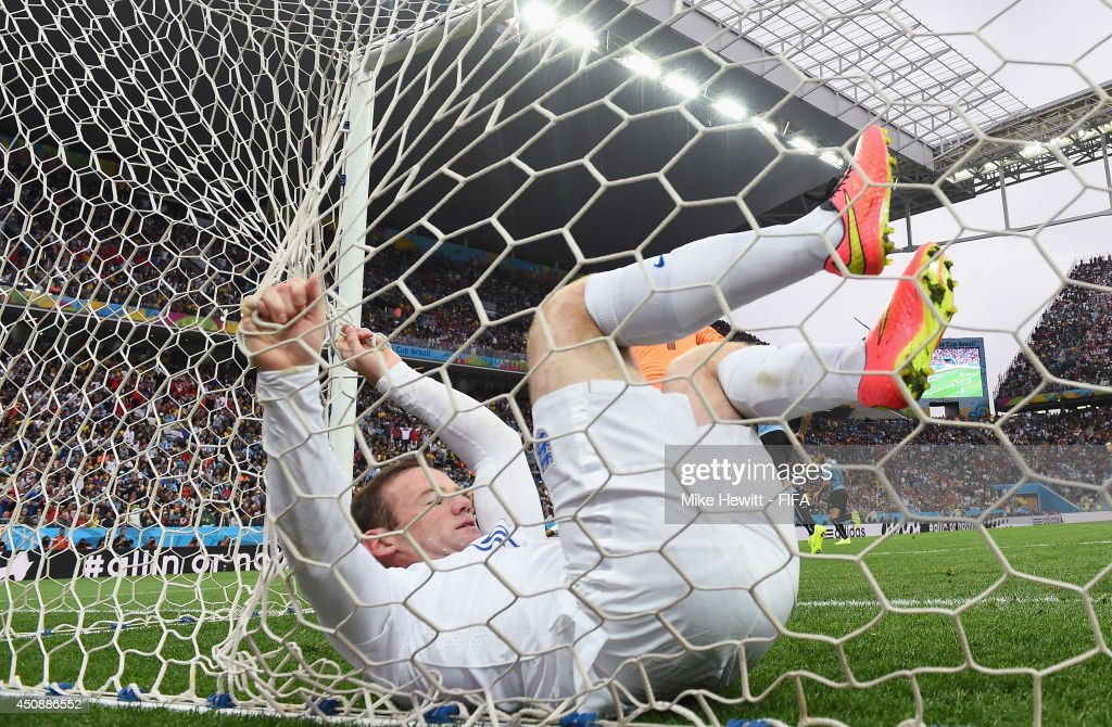 Wayne Rooney of England dives into the net after his header hitting a bar during the 2014 FIFA World Cup Brazil Group D match between Uruguay and England at Arena de Sao Paulo on June 19, 2014 in Sao Paulo, Brazil.