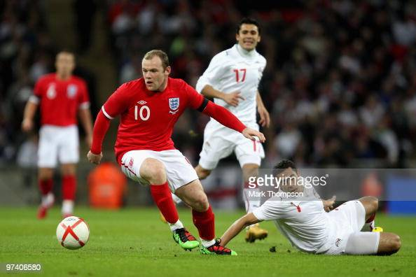 Wayne Rooney of England evades Ahmed Fathy of Egypt during the International Friendly match between England and Egypt at Wembley Stadium on March 3...