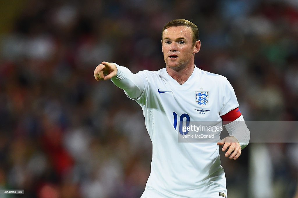 Wayne Rooney of England gestures during the International friendly match between England and Norway at Wembley Stadium on September 3 2014 in London...