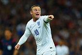 Wayne Rooney of England gives instructions during the UEFA EURO 2016 Group E qualifying match between England and Switzerland at Wembley Stadium on...