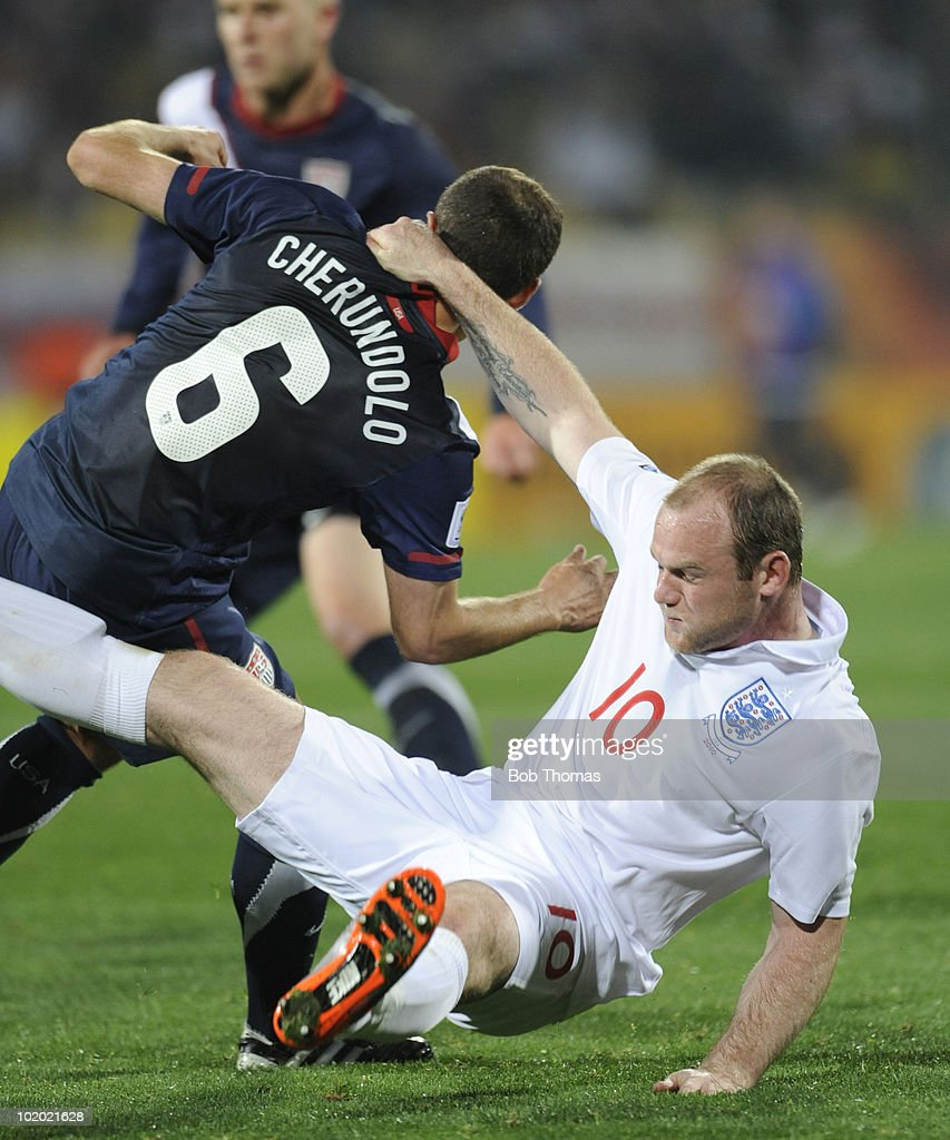 Wayne Rooney of England grabs hold of Steve Cherundolo of the USA during the 2010 FIFA World Cup South Africa Group C match between England and USA...