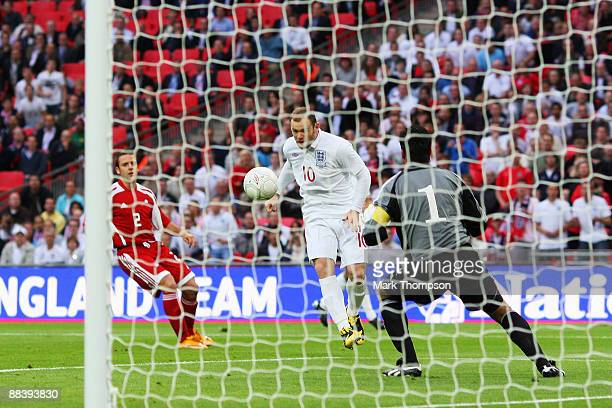 Wayne Rooney of England heads and scores the first goal of the game during the FIFA 2010 World Cup Group 6 Qualifying match between England and...