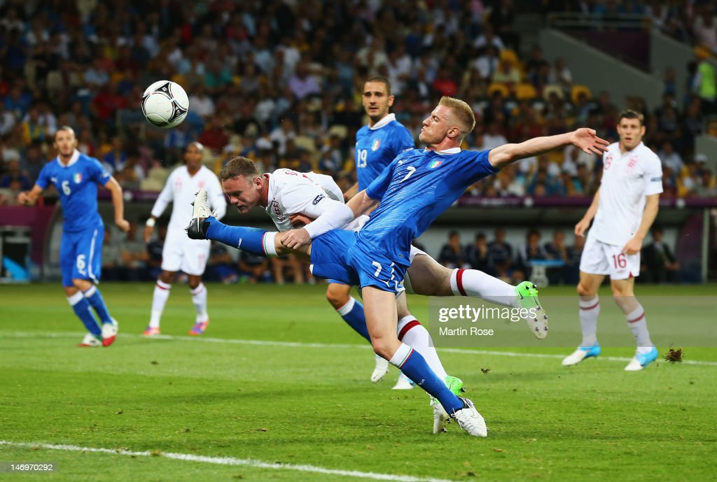 Wayne Rooney of England heads towards goal as Ignazio Abate of Italy challenges during the UEFA EURO 2012 quarter final match between England and Italy at The Olympic Stadium on June 24, 2012 in Kiev, Ukraine.