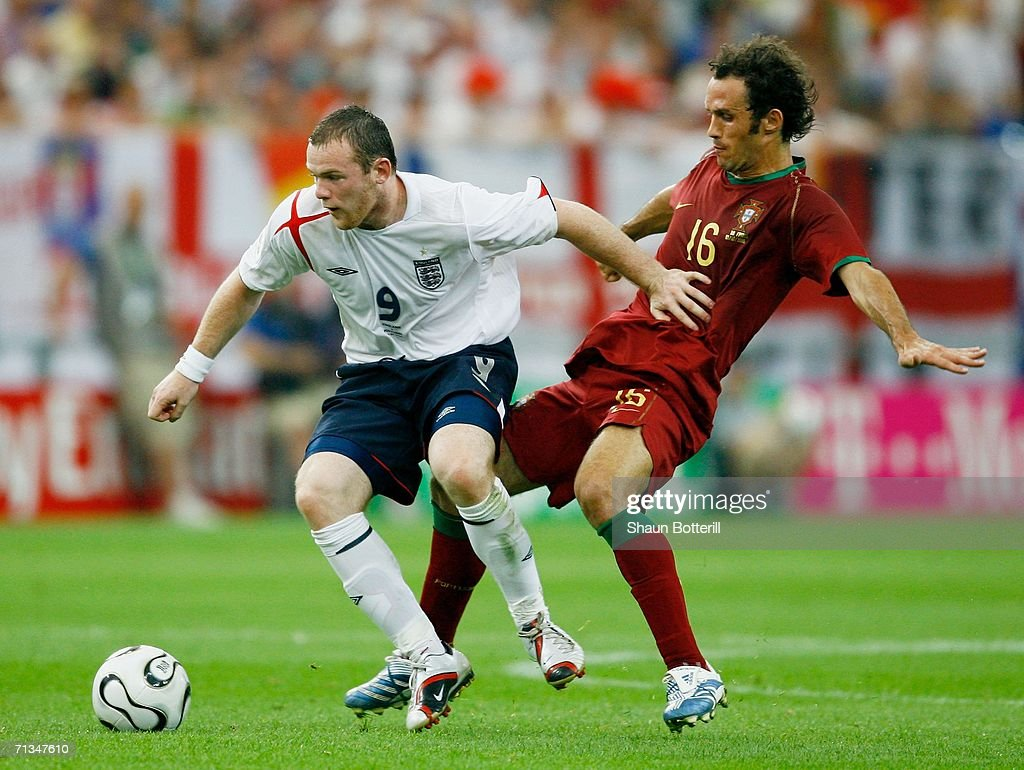 Wayne Rooney of England holds off Ricardo Carvalho of Portugal during the FIFA World Cup Germany 2006 Quarterfinal match between England and Portugal...