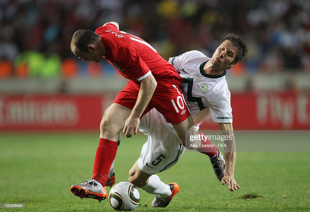 <a gi-track='captionPersonalityLinkClicked' href=/galleries/search?phrase=Wayne+Rooney&family=editorial&specificpeople=157598 ng-click='$event.stopPropagation()'>Wayne Rooney</a> (L) of England in action against <a gi-track='captionPersonalityLinkClicked' href=/galleries/search?phrase=Bostjan+Cesar&family=editorial&specificpeople=2084483 ng-click='$event.stopPropagation()'>Bostjan Cesar</a> of Slovenia during the 2010 FIFA World Cup South Africa Group C match between Slovenia and England at the Nelson Mandela Bay Stadium on June 23, 2010 in Port Elizabeth, South Africa.