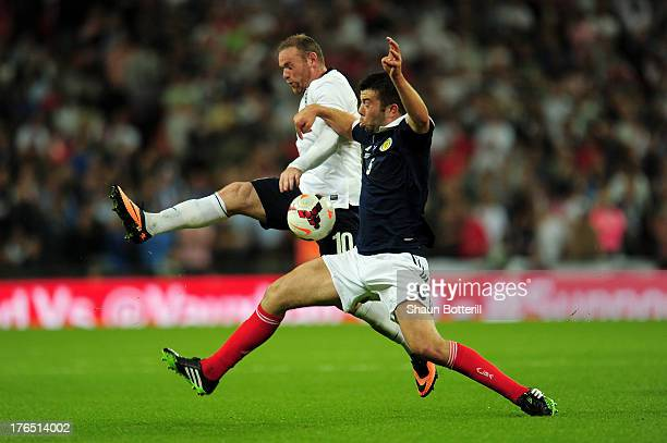 Wayne Rooney of England in action against Grant Hanley of Scotland during the International Friendly match between England and Scotland at Wembley...