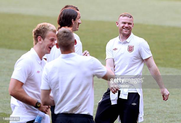 Wayne Rooney of England inspects the pitch during a UEFA EURO 2012 training session at the Donbass Arena on June 18 2012 in Donetsk Ukraine