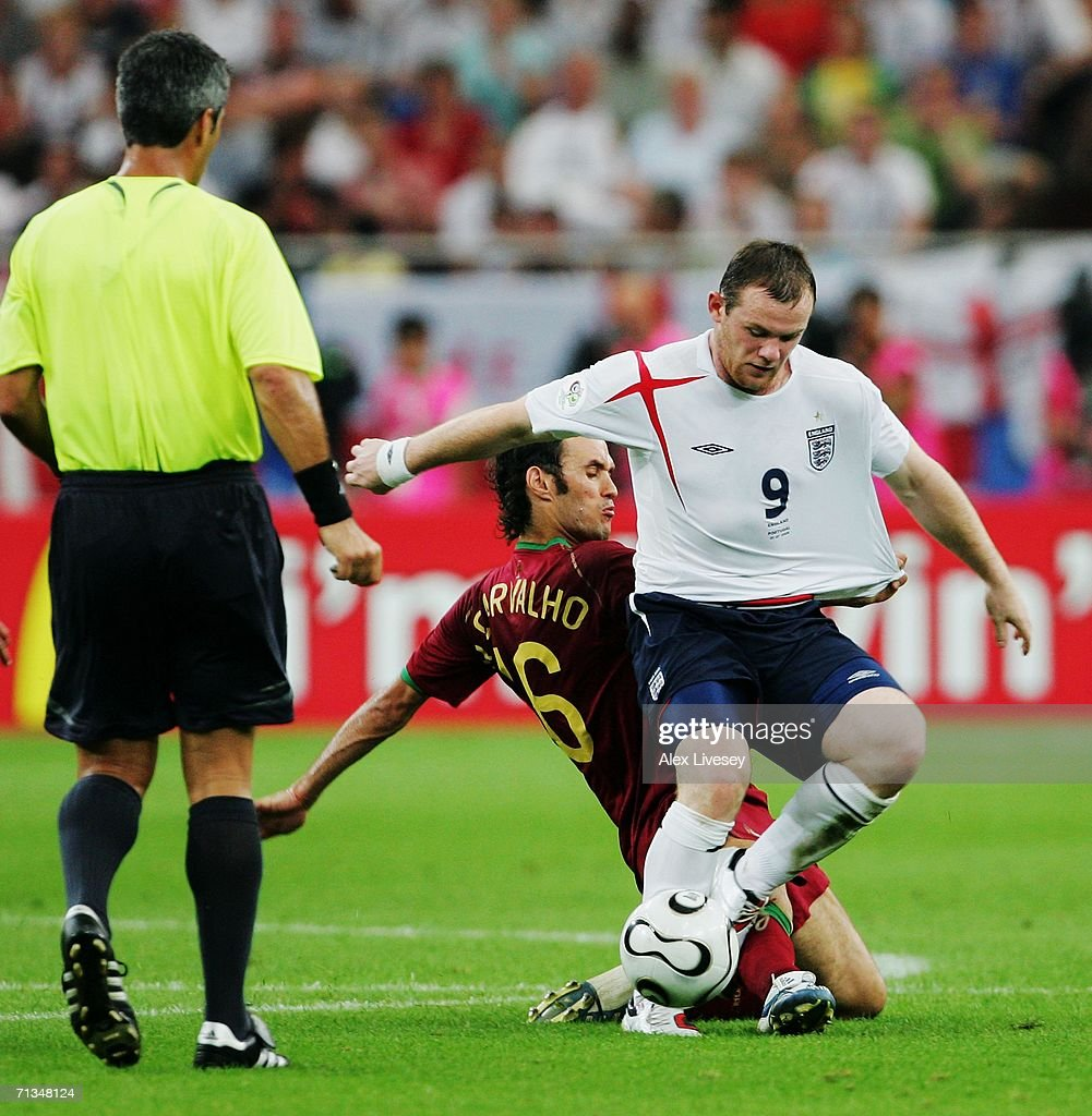 Wayne Rooney of England is challenged by Ricardo Carvalho of Portugal prior to Rooney's sending off during the FIFA World Cup Germany 2006...