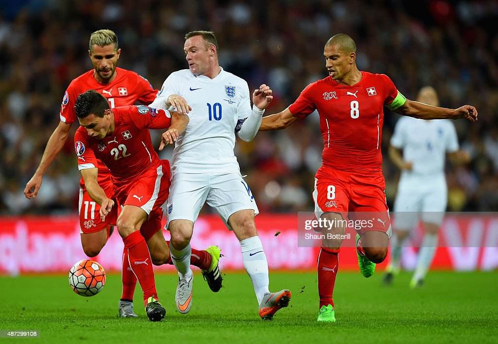 <a gi-track='captionPersonalityLinkClicked' href=/galleries/search?phrase=Wayne+Rooney&family=editorial&specificpeople=157598 ng-click='$event.stopPropagation()'>Wayne Rooney</a> of England is closed down by Fabian Schar (L) and Gokhan Inler (R) of Switzerland during the UEFA EURO 2016 Group E qualifying match between England and Switzerland at Wembley Stadium on September 8, 2015 in London, United Kingdom.