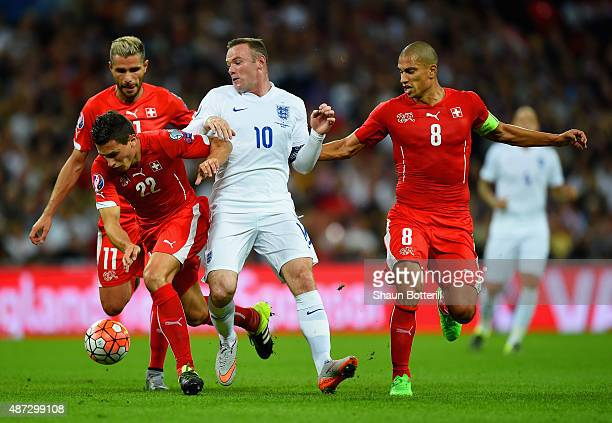 Wayne Rooney of England is closed down by Fabian Schar and Gokhan Inler of Switzerland during the UEFA EURO 2016 Group E qualifying match between...
