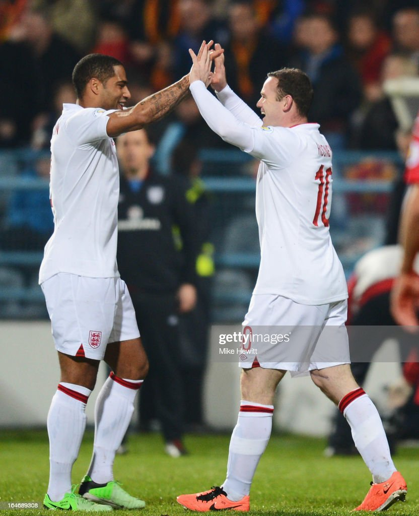 <a gi-track='captionPersonalityLinkClicked' href=/galleries/search?phrase=Wayne+Rooney&family=editorial&specificpeople=157598 ng-click='$event.stopPropagation()'>Wayne Rooney</a> (R) of England is congratulated by <a gi-track='captionPersonalityLinkClicked' href=/galleries/search?phrase=Glen+Johnson&family=editorial&specificpeople=209192 ng-click='$event.stopPropagation()'>Glen Johnson</a> after scoring the opening goal during the FIFA 2014 World Cup Qualifier Group H match between Montenegro and England at City Stadium on March 26, 2013 in Podgorica, Montenegro.