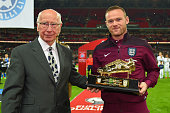 Wayne Rooney of England is presented with the Golden Boot by Sir Bobby Charlton after breaking his record of 49 goals during the UEFA EURO 2016 Group...