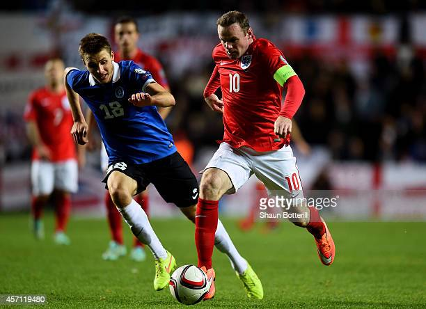Wayne Rooney of England is pursued by Karol Mets of Estonia during the EURO 2016 Qualifier match between Estonia and England at A Le Coq Arena on...