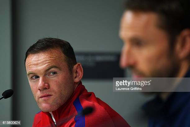 Wayne Rooney of England looks at Interim Manager Gareth Southgate during an England press conference ahead of the FIFA 2018 World Cup Qualifier Group...