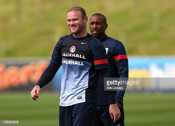 Wayne Rooney of England looks on during a training session at St Georges Park on August 12 2013 in BurtonuponTrent England