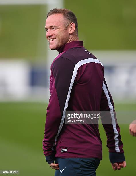 Wayne Rooney of England looks on prior to a England training session at St Georges Park on September 2 2015 in BurtonuponTrent England