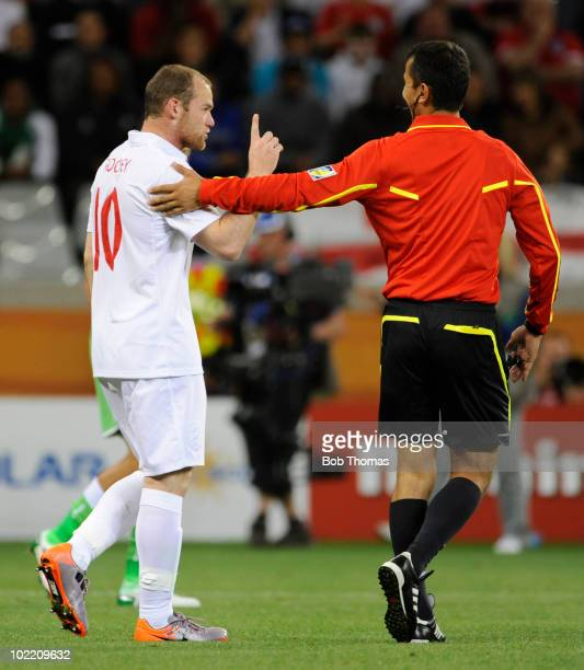 Wayne Rooney of England makes a point to to referee Ravshan Irmatov during the 2010 FIFA World Cup South Africa Group C match between England and...